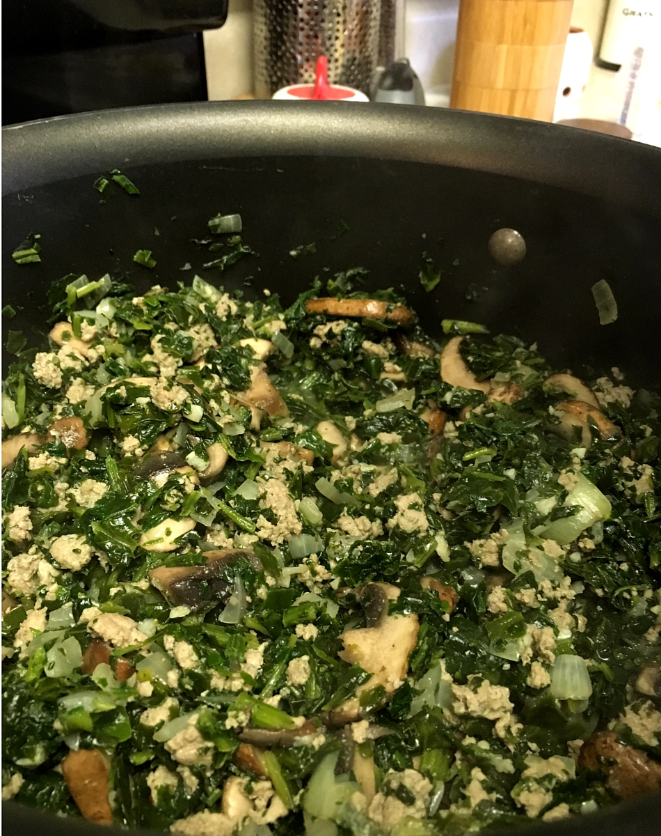 Add spinach to turkey and mushrooms, then reduce the heat