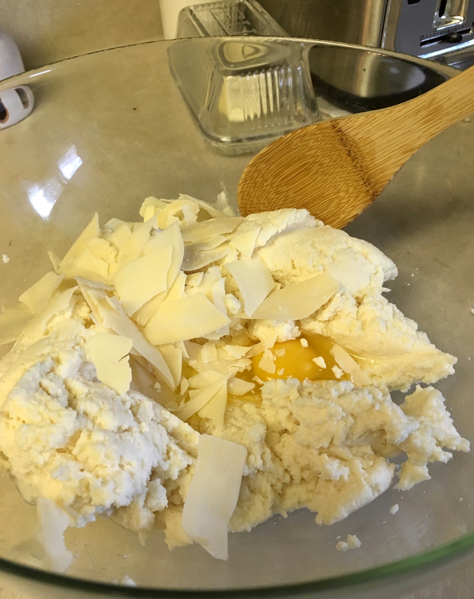 Combine ricotta, egg, and cheese