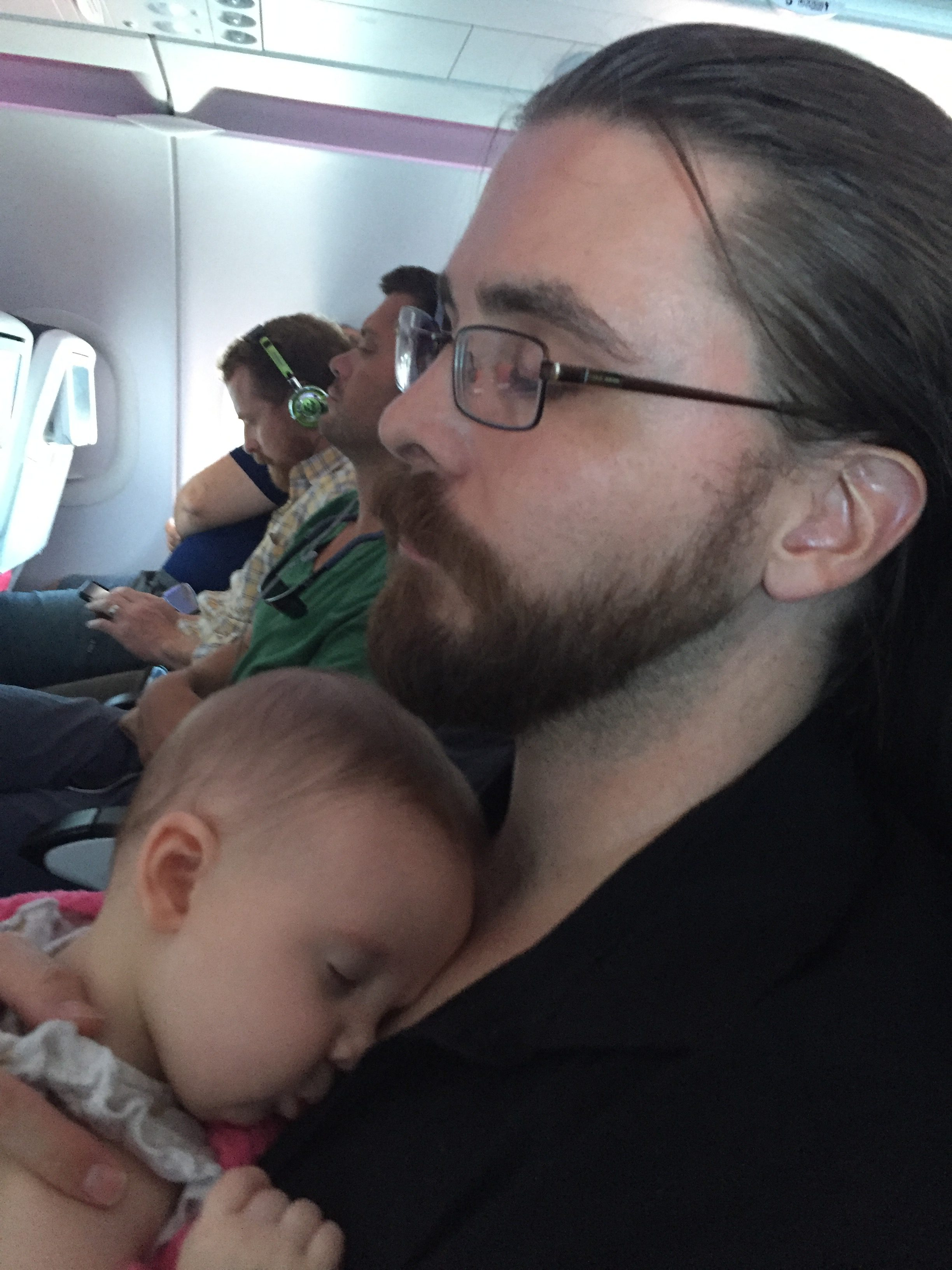 Madeline sleeping like a champ on the plane!