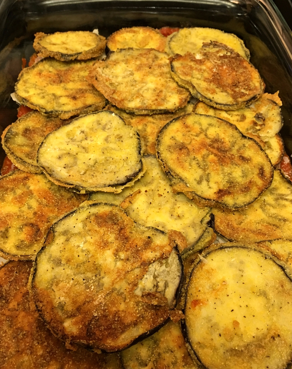 Layer eggplant, sauce, and parmesan in a casserole dish