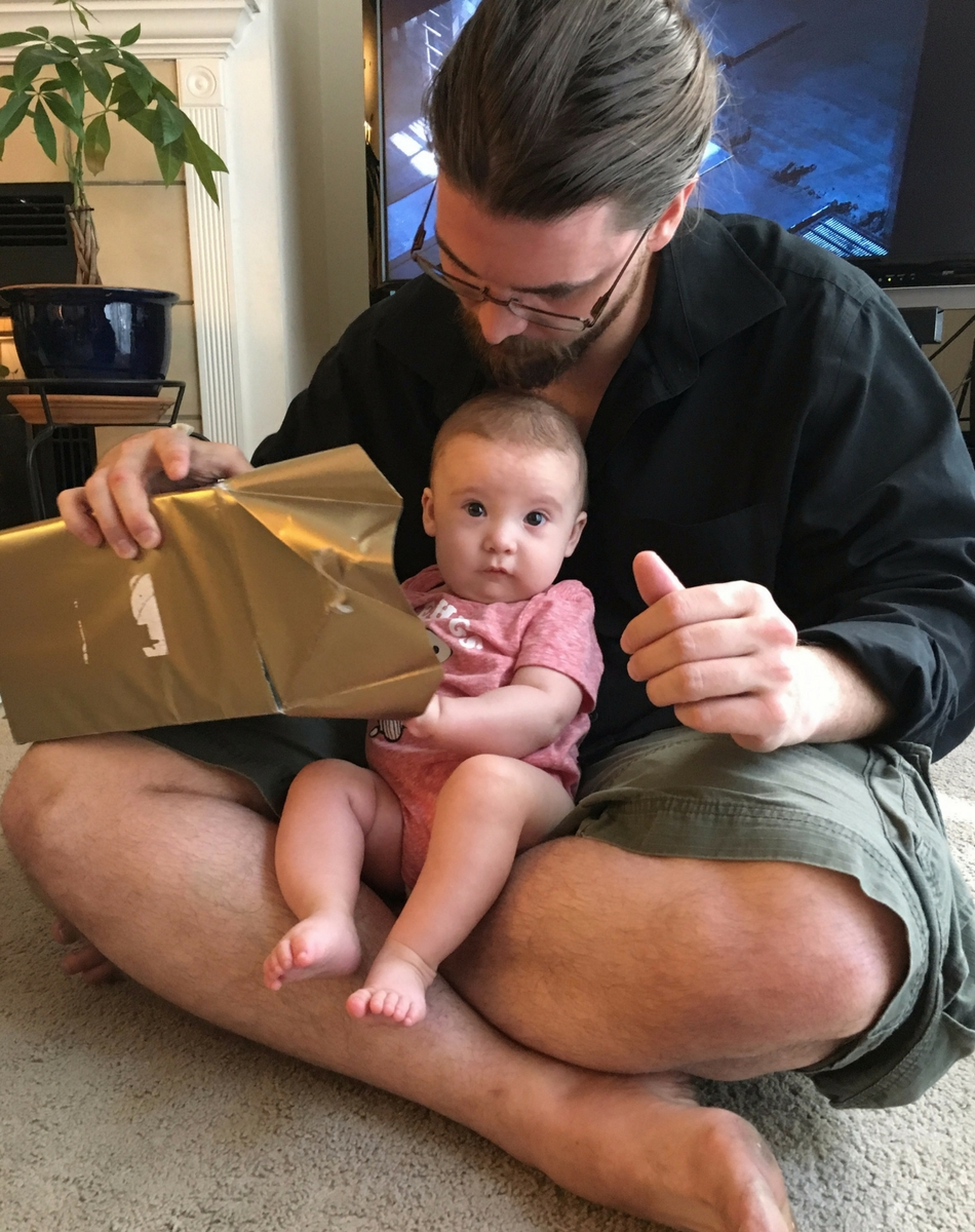 Opening gifts with daddy (she's so helpful)